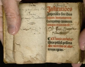 "Photo of a book of the ""Institutes of Justinian"""