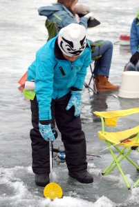 Young angler ice fishing. Photo taken from flickr.com